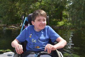 boy sitting in a wheelchair