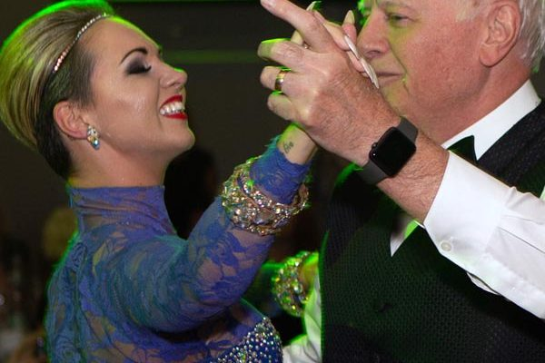 A man dances with his professional partner