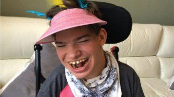 A boy smiles