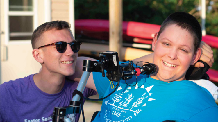 Ben outside with an Easter Seals camper