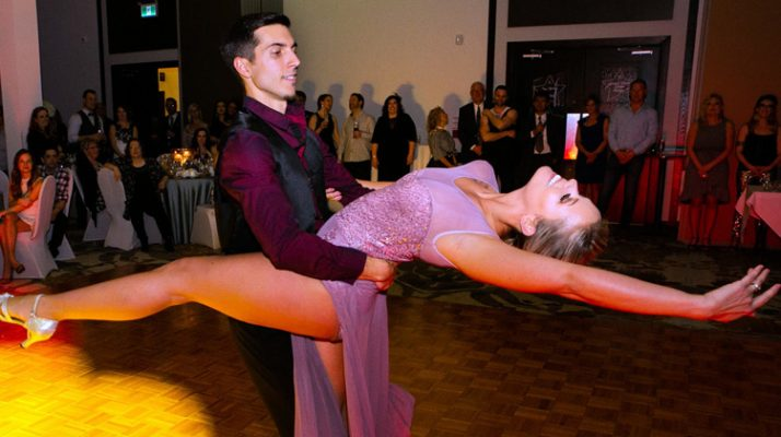 Adam dips Ashley on the dance floor