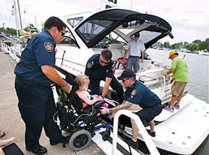 Helping an Easter Seals family onto the boat