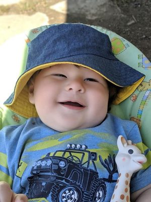 Nathan as a baby in hat